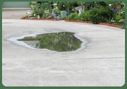 pooling water driveway damage